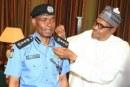Buhari decorates new Inspector General of Police, Abubakar Adamu