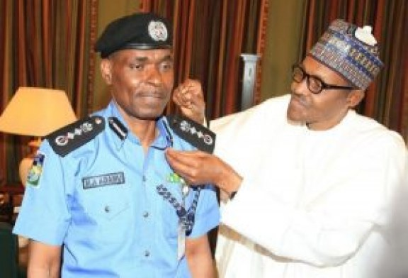 Buhari decorates new Inspector General of Police, Abubakar Adamu